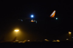 EasyJet A320 G-EZOU, Bristol Airport (Bristol Airport Spotter) Tags: night plane bristol lights airport jet apron landing final finals airbus flare passenger approach 27 runway easyjet a320 brs a38 eggd