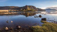 Eilean Donan Castle (sandergroffen) Tags: bridge lake reflection castle water landscape photography golden scotland rocks colours unitedkingdom ducks hour loch eilean donan