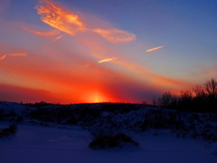 Sun pillar over Bluebird Estates (peggyhr) Tags: blue sunset sky orange white canada black yellow clouds island purple hill cream magenta silhouettes alberta mauve frozenlake sunpillar 25faves peggyhr bluebirdestates dsc02348a