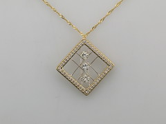 Spider web diamond pendant with Princess cut diamonds 14kt yg