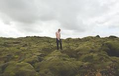 untitled (Annasara Bjaaland) Tags: blue boy sky man color green colors rock stone clouds naked landscape island lava iceland moss rocks soft colours skin stones surrealism north surreal human heim heima