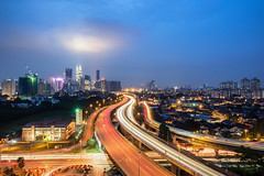 Spotlight (Mabmy) Tags: city lines buildings lumix lights highway trains olympus spotlight vehicles lighttrails bluehour kualalumpur roads kl ultrawide klcc em1 7mm livecomposite