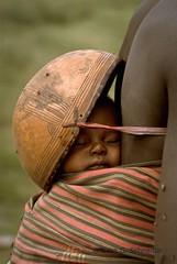 Nigeria.  Sleeping baby with helmet  // Evan G. Schneider (mike catalonian) Tags: africa portrait face children photography nigeria westernregion evangschneider
