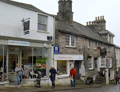 Street in Kendal (Tony Worrall Foto) Tags: road county street uk england people urban building english architecture town stream tour open place northwest unitedkingdom candid country north visit location cumbria area shops northern update quaint built shoppers attraction westmorland welovethenorth