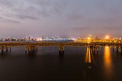 The Nam 023 (Cycle the Ghost Round) Tags: city bridge urban orange reflection water night river view vietnam danang hanriver
