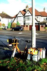 bike number 32 (SociétéRoyale) Tags: road orange bike bicycle liverpool post mail suburbia tnt 32 postman postie gateacre woolton scouse l25 postbike whistl