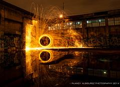 Urban Reflection (roo8791) Tags: street light urban reflection art wool water oregon dark portland puddle fire graffiti nikon pacific northwest steel burning nighttime burn sparks pnw might