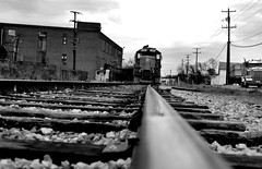 DSC_0180 (luvjuego) Tags: street wood trees windows shadow sky sunlight white black building texture glass lines wall architecture clouds train truck georgia photography rocks factory afternoon power bricks rustic tracks structure poles rossville