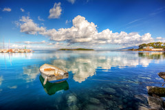 Reflections of Blue (Nejdet Duzen) Tags: trip travel blue reflection turkey boat cloudy trkiye mavi iskele sandal izmir yansma turkei seyahat urla