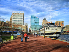 Baltimore's Inner Harbor in Winter (` Toshio ') Tags: city winter people usa architecture clouds buildings harbor boat downtown december ship cityscape path walk maryland baltimore sidewalk hdr highdynamicrange innerharbor toshio xe2 spiritofbaltimore fujixe2