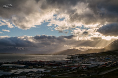 Usuahia, Argentina (La Sociedad Heliogrfica) Tags: sunset sea patagonia sunlight mountains sol argentina clouds landscape tierradelfuego ushuaia canaldebeagle mar sunny paisaje nubes citylandscape montaas damiandeamorin