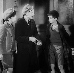 Steal the scene (theirhistory) Tags: uk london film boys hat kids children mac war wwii kinderen tie crime jacket cap gb ww2 jumper shorts 1942 raincoat adults villians bfilm johntacchi