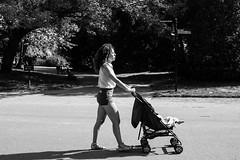 Profile of a mother (EyeOfTheLika) Tags: park street travel family summer blackandwhite bw woman black london kids candid profile mother lifestyle lika motherhood streetbw 500px ifttt