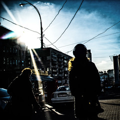 Plugged in since the very morning (kirilko) Tags: sunshine fuji streetphotography highcontrast bluesky ukraine wires headphones wired kiev kyiv  contrejour fujifinepix deepcontrast  bsquare   squareframed finepixx100 fujix100