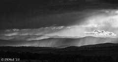 Showers over the Brindabellas - BW (i-lenticularis) Tags: sky mountains clouds landscape australia m8 canberra sunray brindabellas leicam8 voigtlandermc90f35apolanthar