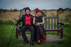 DSC_0114 (jameshowardphotography) Tags: smile smiles love gothic goth cane red black whitby yorkshire north northyorkshire northeast northern st stmaryschurch bench wedding hat dress dracula suit