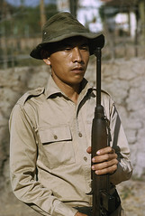 SAIGON 1965 - Mt ngha qun trong t th sng cho. Photo by Wilbur E. Garrett (manhhai) Tags: color men up vertical outdoors person photography one war day vietnamese adult image rifle young vietnam waist weapon guarding ethnicity