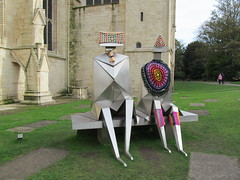 No sculptures were harmed during the making of this graffiti! (pefkosmad) Tags: street city urban sculpture art wool public knitting funny exterior cathedral crochet exhibition gloucestershire yarn gloucestercathedral lynnchadwick guerillaknitting crucible2 yarnbombing sittingcoupleonabench naughtyknitter