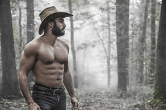 In the Wood (Ben Heine) Tags: wood trees light nature muscles hat sport forest beard landscape photography freedom model cowboy photographer lumire profile free arbres chapeau torso lumberjack fort bois torse pantalon fumes woodcutter trouser benheine bcheron