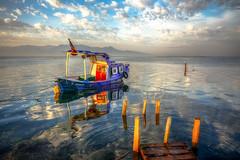 A Boat (Nejdet Duzen) Tags: trip travel sea reflection turkey boat purple cloudy trkiye deniz sandal mor izmir yansma turkei seyahat bostanl bulutlu maviehir