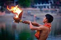 Brahmin performing Aarti pooja ceremony on bank of river Kshipra in Ujjain
