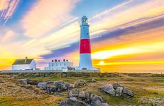 Lighthouse under a colourful sky. (Anthony White) Tags: light sky lighthouse seascape sunrise portland rocks dorset colourful sonyalpha weymouthandportlanddistrict