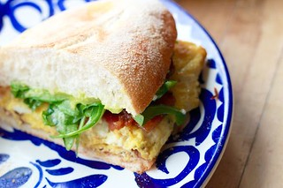 Torta de Candied Bacon and Egg | ($7) famous candied jalapeño bacon with scrambled eggs, refried beans, avocado and arugula Photo: Fonda Lola