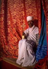 Ethiopian orthodox priest holding a cross inside a rock church, Amhara region, Lalibela, Ethiopia (Eric Lafforgue) Tags: africa travel red man color men vertical outdoors worship cross adult african curtain faith religion unescoworldheritagesite celebration holy indoors sacred priest christianity shawl spirituality ethiopia orthodox religiouscelebration oneperson traditionalculture lalibela hornofafrica ethiopian eastafrica thiopien etiopia abyssinia ethiopie traditionalclothing etiopa onlymen fulllenght onemanonly onematuremanonly  etiopija 1people ethiopi  africanculture etiopien etipia  etiyopya  amhararegion         semienwollozone ethio163657