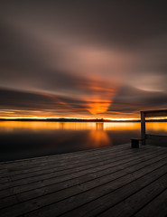 dreamon-25 (Odar Gofot) Tags: wood sunset red sky sun lake reflection tree water norway clouds pier lakescape
