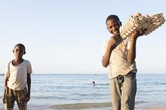 The happiest eggs seller on earth... (Srgio Miranda) Tags: africa street travel boy people urban beach photography photo streetphotography fujifilm mozambique moz moambique pemba travelphotography x100 fujix sergiomiranda x100t fujix100t