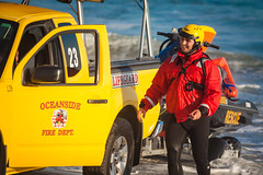 Oceanside Lifeguards (EthnoScape) Tags: oceanside california cityofoceansidelifeguard lifeguards oceansidelifeguard oceansidelifeguards training trainer assistance drown drowning surf surfer surfboard lifesaver lifesavers rescue rescuer rescuetube rookie swim swimming swimmer swimmers athlete athletic health fitness youth boardshorts bikini wetsuit neoprene lycra rubber fiberglass polyurethane danger riptide ripcurrent red yellow baywatch fins swimfins tower lifeguardtower beach shore ocean water safety tourist touristseason jetski summer ethnoscape ethnoscapeimagery outdoor