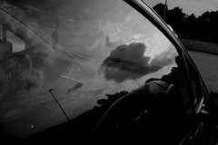 Twilight reflections (Daphne Wolfsong) Tags: street sky urban blackandwhite white black reflection window monochrome car clouds vintage reflections evening twilight afternoon retro nostalgia indie