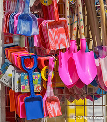 Multicoloured beach toys (Philip Lench) Tags: isleofwight hampshire beachtoys bucket spade multicoloured ryde