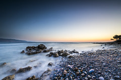 Tavronitis, Crete. Long exposure at dawn. (sfrancis23) Tags: tavronitis crete long exposure dawn lee little stopper sw150 sea seascape landscape pebbles rocks shore water sunrise orange blue nikon d810 1424mm nd grad beach
