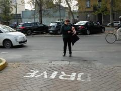 Donna con Cicciobello (GrusiaKot) Tags: weird donna italia milano giocattolo cicciobello