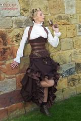IMG_1419 (Neil Keogh Photography) Tags: brown white black female bronze bag gold gun dress boots goth blouse magnifyingglass corset guns clockwork handbag steampunk whitbyabbey fishnettights whitbygothweekend tophatgoggles