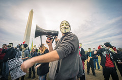 Million Mask March - Washington DC (Cosmic Smudge) Tags: signs march washingtondc dc voigtlander whitehouse rally protest guyfawkes dcist anonymous anarchists november5th fifthofnovember ows voigtlandersuperwideheliar15mmf45 sonya7 millionmaskmarch