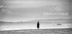 She (Jose Regueiro) Tags: she sea bw beach girl coast spain corua loneliness walk galicia