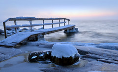 Icy pier on a cliff (tinamar789) Tags: winter sunset sea cliff mist snow seascape cold ice water fog landscape helsinki rocks frost horizon freezing seashore