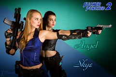 SP2: Angel and Skye (FightGuy Photography) Tags: blue emily dangerous gorgeous blueeyes rifle armor blonde flashlight guns brunette m4 pistols jessi studioa colt45 studiophotography womenwithweapons suckerpunched fightguyphotography