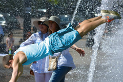 Fly By Surprise (swong95765) Tags: ladies guy fountain jump women dive leap surprising