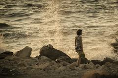 ... (Theophilos) Tags: sea girl rocks wave crete splash rethymno