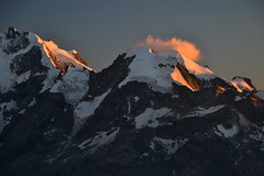 Alpenglow on the ice ridges (echumachenco) Tags: berninagruppe pizbernina pizmorteratsch pizroseg crest ridge ice snow rock mountain alps outdoor evening alpenglow alpineglow biancograt glacier crevasse sunset cloud light shadow engadin pizlanguard grisons graubnden pontresina switzerland schweiz suisse svizzera suiza nikond3100
