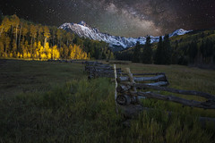 Mt Sneffels and the Milky Way (wishiwsthr) Tags: ranch lightpainting yellow night fence colorado meadow grassland milkyway snowcappedmountains mtsneffels sanjuanmountainrange wishiwsthr