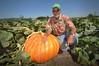 Farmer David Brown posing next to one of by USDAgov, on Flickr