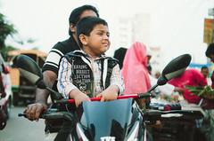The Young Visitor in Haat (Sheikh Shahriar Ahmed) Tags: boy bike digital kid child candid father son motorcycle dhaka bazaar weekly haat bangladesh irritated banasree candidportrait dhakadivision meradia sheikhshahriarahmed