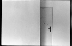 (The Broken Camera) Tags: door bw geometric analog wooden flat minolta interior room silence walls accommodation simple whitewall abode deadpan dwelling longtimeexposure existential doorajar przemyslaw blissfulsolitude rentedflat stroinski abidance