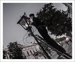 Lighting up your day... (Bram du Saar) Tags: lighting street city costumes sunset clock canon lights uniform time anniversary buttons traditional great broadway tourist tourists special peter brest lanterns 17 ritual ladder lantern wish belarus 2009 rubbing garments touristic kerosene romanov lamplighter extinguishing shoppingstreet беларусь g9 pedestrianized cs6 брэст 990th sovetskaya witrusland sovetskayastreet брест brestlitovsk photolabaj extinguishes alekseyevich republicofbelarus берасьце balarusian berestye witrussisch беларускаямова ulitsasovetskaya vulicasaveckays oldstylejacket bramdusaar