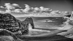 Durdle Door (Nigel Jones QGPP) Tags: longexposure sea sky blackandwhite beach mono rocks cliffs dorset durdledoor