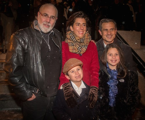 WaterFire creator Barnaby Evans poses with Governor Gina Raimondo, her husband Andy Moffit, son Tommy, and daughter Ceci. Photo by Jen Bonin.
